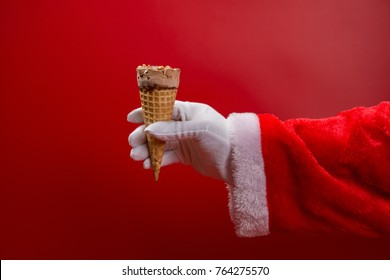 santa claus holding an ice cream cone on red