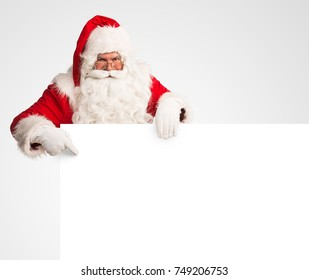 Santa Claus holding a large blank sign