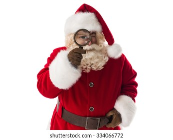 Santa Claus holding magnifier Closeup Portrait. Isolated on White Background