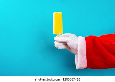 santa claus holding a popsicle in front of a blue background