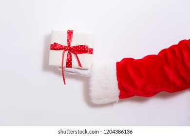 Santa claus holding a present box on a white background