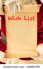 Santa Claus holding scroll paper blank in hands. Christmas holiday concept