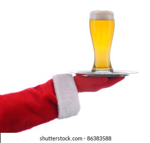 Santa Claus holding a serving tray with a glass of beer over a white background.