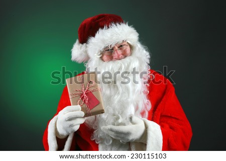 Santa Claus Holds Christmas Present You Stock Photo Edit Now