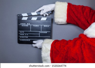 Santa Claus holds film flap in hand