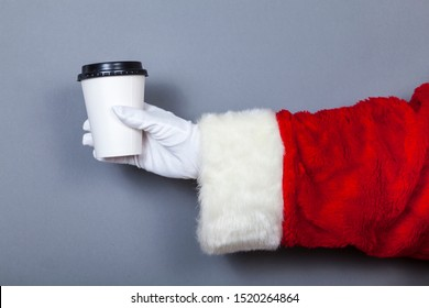 Santa Claus holds paper cup