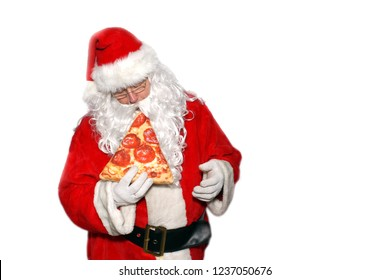 Santa Claus. Isolated on white. Room for text. Santa Claus enjoys and Eats a Slice of Pepperoni Pizza.