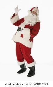 Santa Claus isolated on white background pointing upward