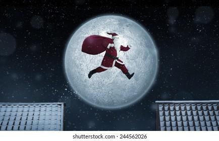 Santa Claus jumping between rooftops at night with bag full of gifts