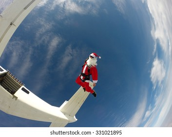 Santa Claus jumping from the plane - Skydiving
