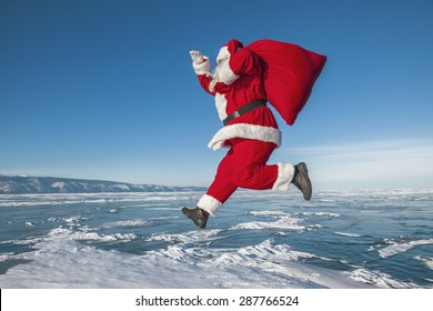 Santa Claus jumps over the frozen lake
