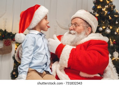 Santa Claus with kids indoors christmas celebration concept