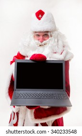 Santa Claus with laptop on white background. Isolated