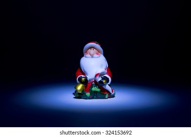 Santa Claus lighted torch from the top like a fairy tale on a black background