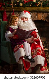 Santa Claus and little girl reading book against Christmas tree and fireplace