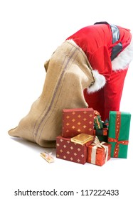 Santa Claus looking for a gift and putting his head in the gifts bag