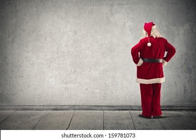 Santa Claus looking the wall