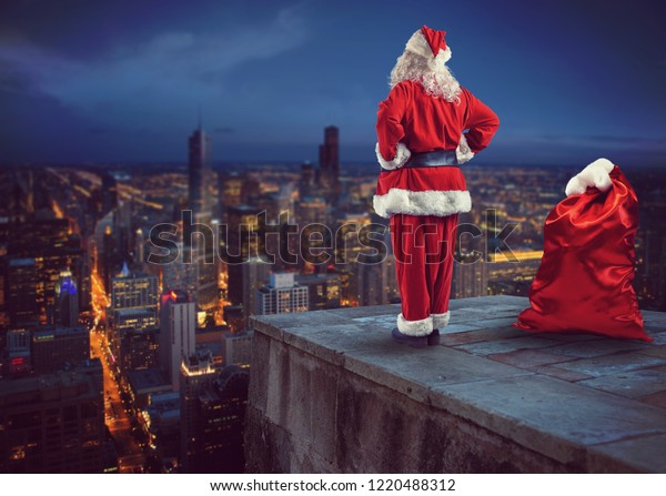 Santa Claus looks down on the city waiting to deliver the presents