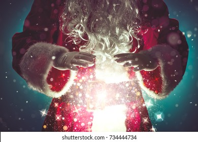 Santa Claus with magic Christmas lights,Christmas concept