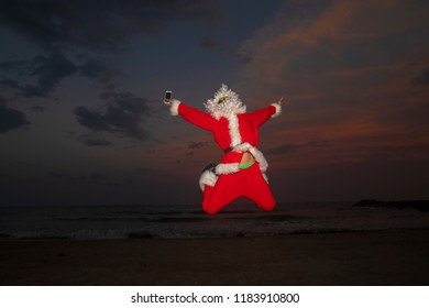 santa claus mobile phone in the beach