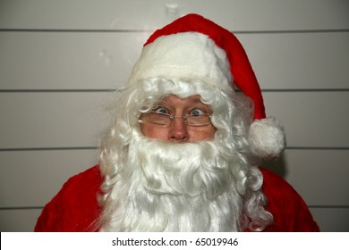 Santa Claus Mugshot. Santa is scared as his mugshot is taken for his arrest photo