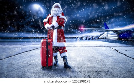 Santa Claus on airport and snow decoration