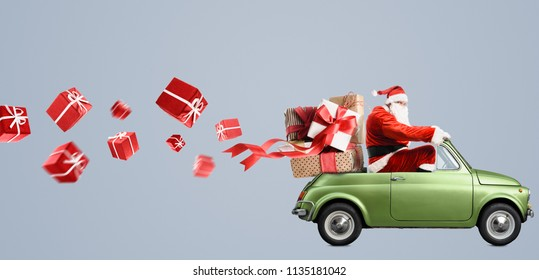 Santa Claus on car delivering Christmas or New Year gifts at gray background