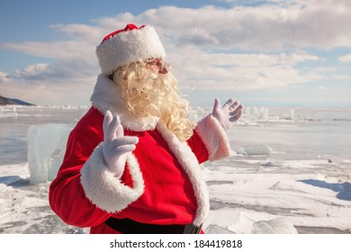 Santa Claus on ice of lake Baikal, shooting was conducted in a sunny day on lake Baikal