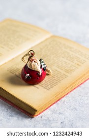 'Santa Claus' on a open and old book