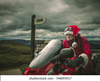 Santa Claus on a red heavy motorcycle at the top of the mountains with pointer with text 2018
