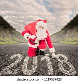 santa claus on a road ready to run. 2018 christmas concept