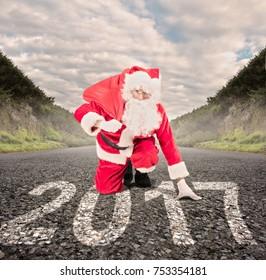 santa claus on a road ready to run. 2017 christmas concept