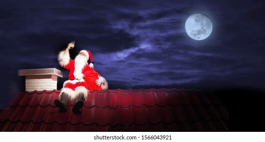 Santa Claus on the roof of a house with tablet