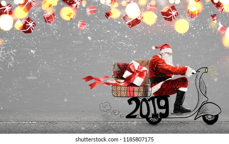 Santa Claus on scooter delivering Christmas or New Year 2019 gifts at snowy gray background