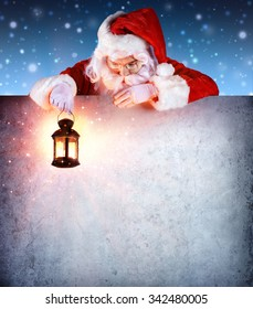 Santa Claus On Vintage Billboard With Lantern