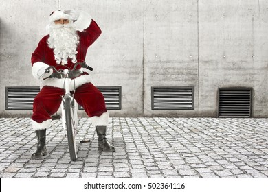 santa claus on white small bike and gray big wall for your decoration