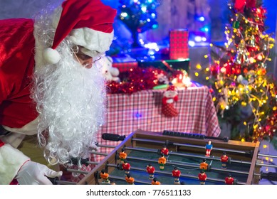 Santa Claus play Tabletop Soccer in the house