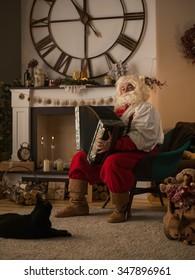 Santa Claus Playing Acordeon at Home