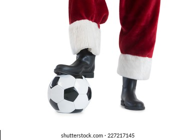 Santa Claus is playing soccer on white background