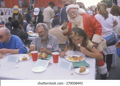 Santa Claus posing with the homeless for Christmas dinner, Los Angeles, California