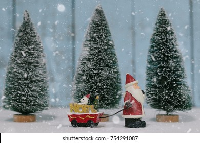 Santa Claus prepare decoration for Cristmas holiday festival. Christmas holiday celebration concept.