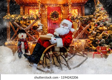 Santa Claus is preparing for Christmas. He writes letters. House of Santa Claus. Christmas decoration.