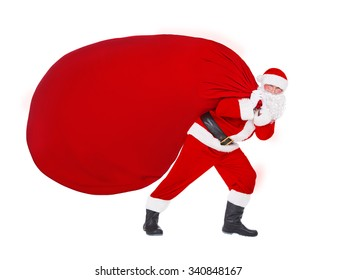 Santa Claus pull the huge Christmas bag full of gifts, presents, and surprises isolated on white background, New Year's or xmas concept