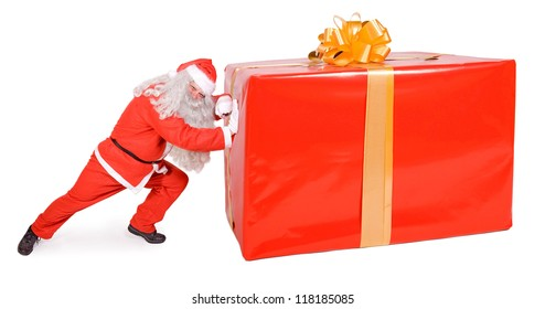 Santa Claus pushes a large package isolated on a white background. Santa Claus pushing a big Christmas gift box. Giant Xmas surprise of present.