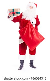 Santa Claus putting Christmas gift into red sack on white background