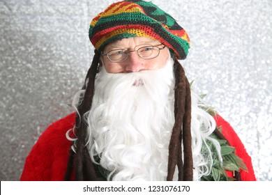 Santa Claus. Rastafarian Santa Claus. Santa wears a Rastafarian Wig and Hat while smoking a Giant Marijuana Cigarette. Santa Smokes Pot.