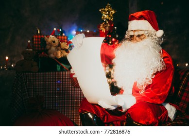Santa claus read a paper at night in the house,The light from the book,Using the light from the lantern room