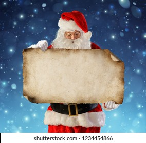 Santa Claus Reading Wish List With Snowfall