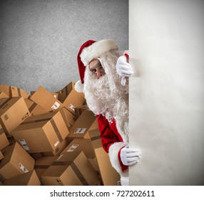 Santa Claus ready to deliver a lot of Christmas presents package