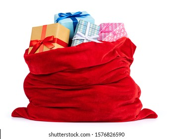 Santa Claus red bag full of Christmas boxes with gifts, isolated on white background. File contains a path to isolation